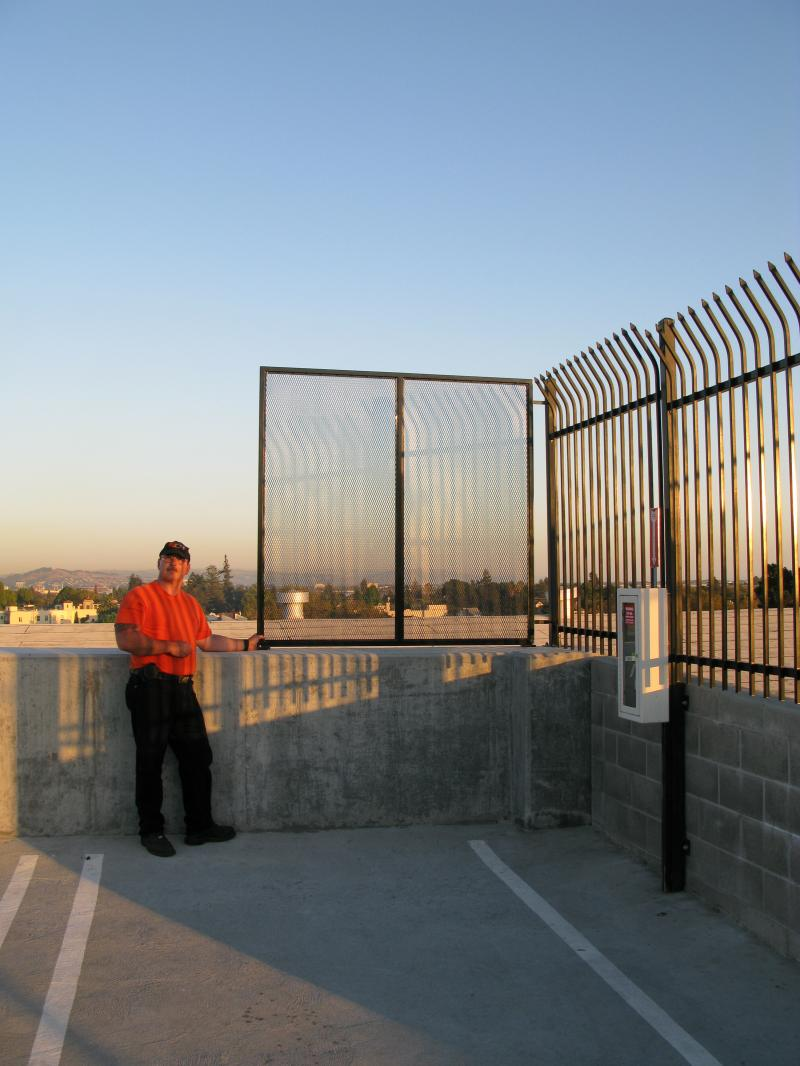 Municipal Safety Barrier:  A simple, sturdy and effective barrier atop a six-sto